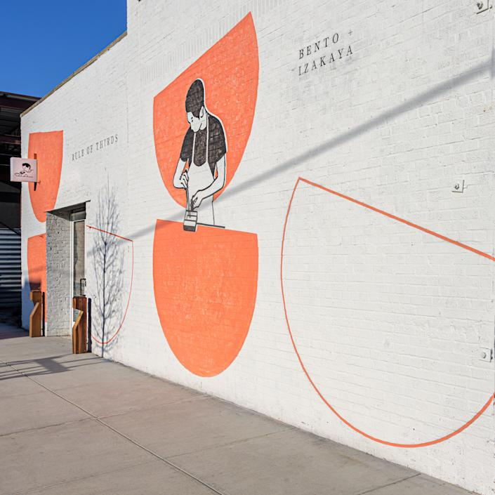 """<div class=""""caption""""> The two-thirds circle logo appears on the exterior of the A/D/O building. </div>"""
