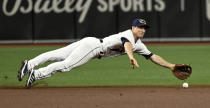 Tampa Bay Rays shortstop Joey Wendle dives for a sharply hit ground ball by Miami Marlins' Lewis Brinson during the first inning of a baseball game Saturday, Sept. 25, 2021, in St. Petersburg, Fla. (AP Photo/Steve Nesius)