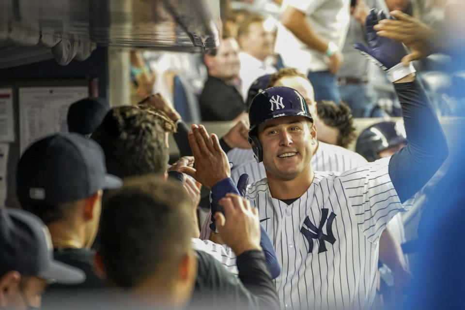 New York Yankees first baseman Anthony Rizzo celebrates with his teammates after hitting a solo home run in the fourth inning of a baseball game against the Baltimore Orioles, Wednesday, Aug. 4, 2021, in New York. (AP Photo/Mary Altaffer)
