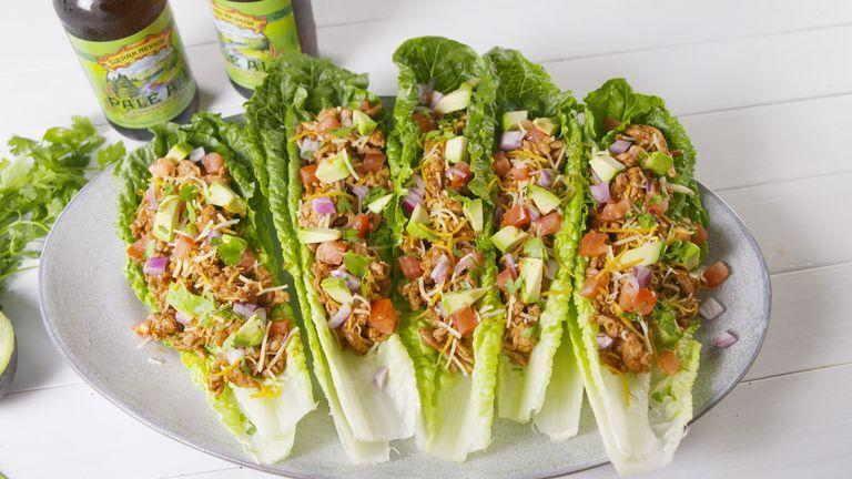 """<p>No bread? No problem! Doubling up on lettuce leaves insures a mess-free lunch, sans the carbs. </p><p>Get the <a href=""""https://www.delish.com/uk/cooking/recipes/a32431738/turkey-taco-lettuce-wraps-recipe/"""" rel=""""nofollow noopener"""" target=""""_blank"""" data-ylk=""""slk:Turkey Taco Lettuce Wraps"""" class=""""link rapid-noclick-resp"""">Turkey Taco Lettuce Wraps</a> recipe. </p>"""