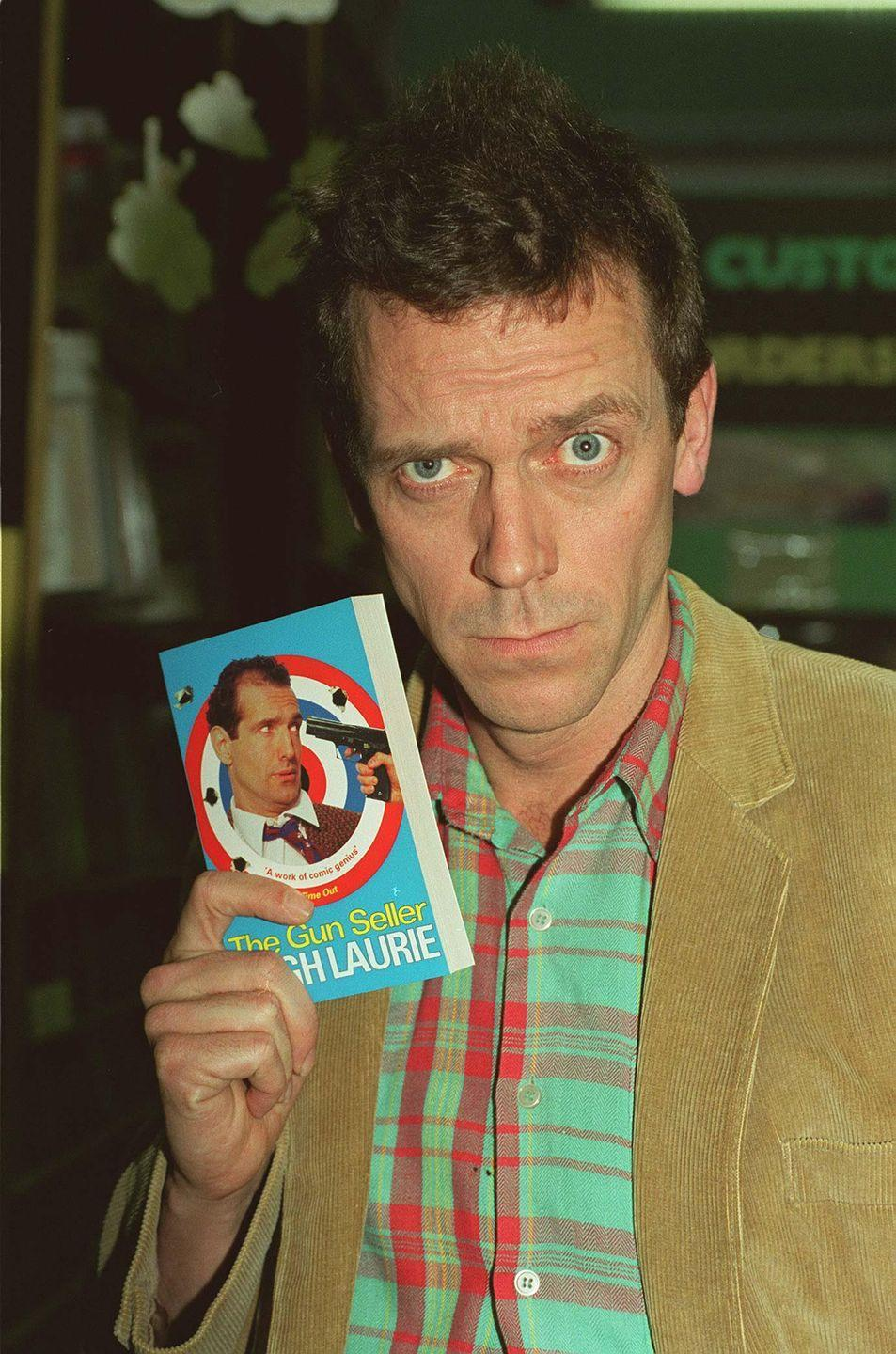 """<p>PSA for anyone who wasn't already in the know: Hugh Laurie is funny. While many fans these days know him as the crotchety Dr. House, Hugh was one half of the comedy duo Fry and Laurie (with fellow British comedian Stephen Fry). The Golden Globe winner tapped into his satirical side for his first novel in 1996, <em>The Gun Seller. </em></p><p><a href=""""https://www.publishersweekly.com/978-1-56947-087-9"""" rel=""""nofollow noopener"""" target=""""_blank"""" data-ylk=""""slk:Publishers Weekly"""" class=""""link rapid-noclick-resp"""">Publishers Weekly</a> referred how Hugh portrays the spy thriller genre as the equivalent of Douglas Adams's take on science fiction with <em>A Hitchhiker's Guide to the Galaxy</em>. </p><p>There's also a story that <em>The Night Manager</em> star initially submitted the manuscript under a pseudonym.</p><p><a class=""""link rapid-noclick-resp"""" href=""""https://www.amazon.com/Gun-Seller-Hugh-Laurie-2004-10-07/dp/B017MYSYIQ/ref=pd_lpo_14_img_0/138-4338020-7856400?_encoding=UTF8&pd_rd_i=B017MYSYIQ&pd_rd_r=f0872f1e-397d-452a-a58d-04b2ae2fcbef&pd_rd_w=shf0L&pd_rd_wg=zd8u2&pf_rd_p=7b36d496-f366-4631-94d3-61b87b52511b&pf_rd_r=HV0A18MKPQGD0X1AQVH5&psc=1&refRID=HV0A18MKPQGD0X1AQVH5&tag=syn-yahoo-20&ascsubtag=%5Bartid%7C2140.g.33987725%5Bsrc%7Cyahoo-us"""" rel=""""nofollow noopener"""" target=""""_blank"""" data-ylk=""""slk:Buy the Book"""">Buy the Book</a></p>"""