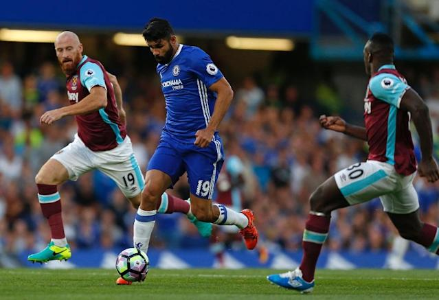 Chelsea's striker Diego Costa (2nd L) vies with West Ham United's defender James Collins (L) and West Ham United's midfielder Michail Antonio during the English Premier League football match at Stamford Bridge in London on August 15, 2016 (AFP Photo/Ian Kington)