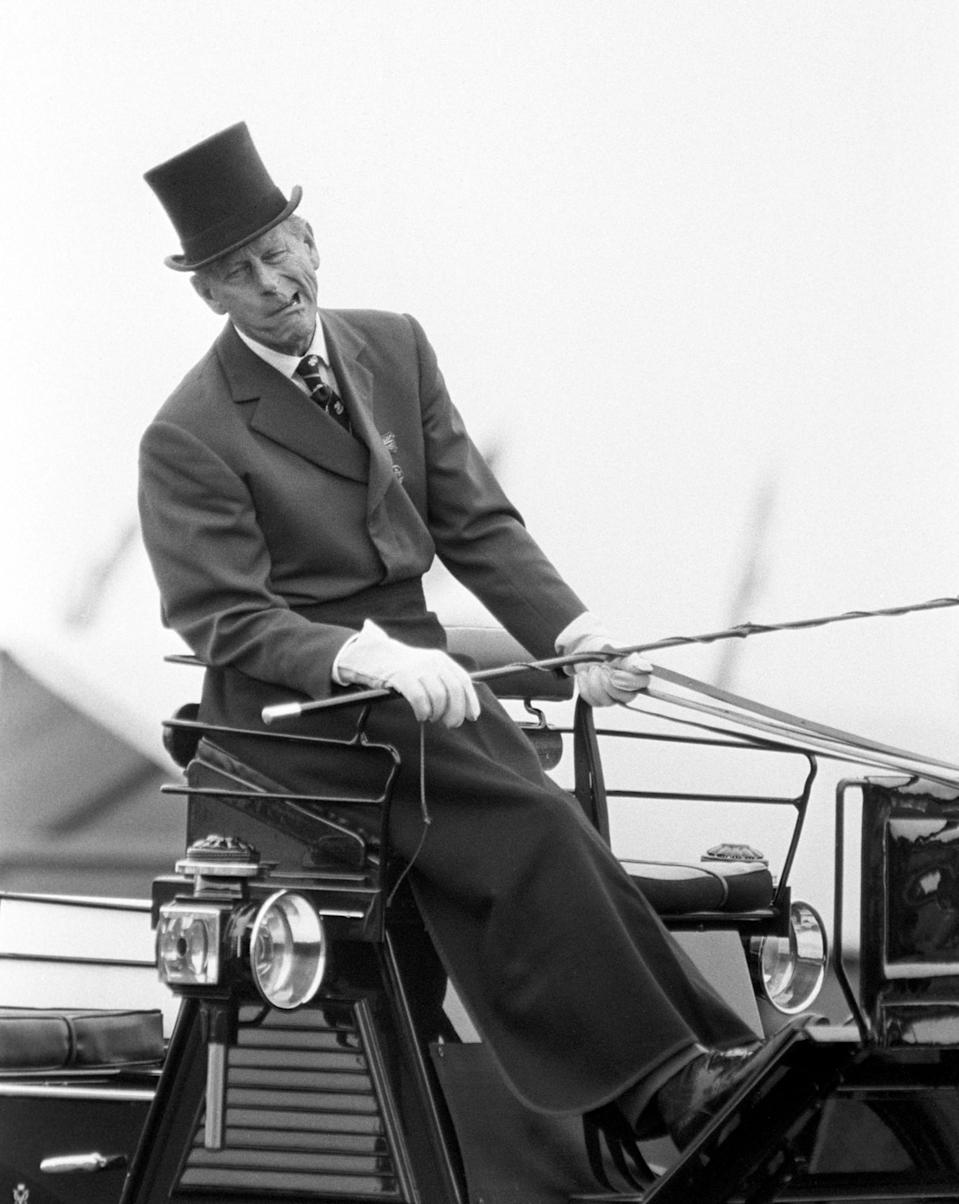 <p>The expression on the Duke's face tells it all. He was impersonating how his horse was biting his bit in an explanation to the judge during the World F.E.I. Four-in-Hand Driving Championship at the Silver Ring racecourse at Ascot, Berkshire. (Photo credit: PA/PA Archive/PA Images) </p>