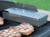 <p>Turn your propane grill into a smoker with the <span>Weber Stainless Steel Smoker Box</span> ($25). </p>