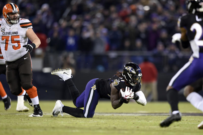 ravens squeeze past browns 26 24 to earn afc north tile