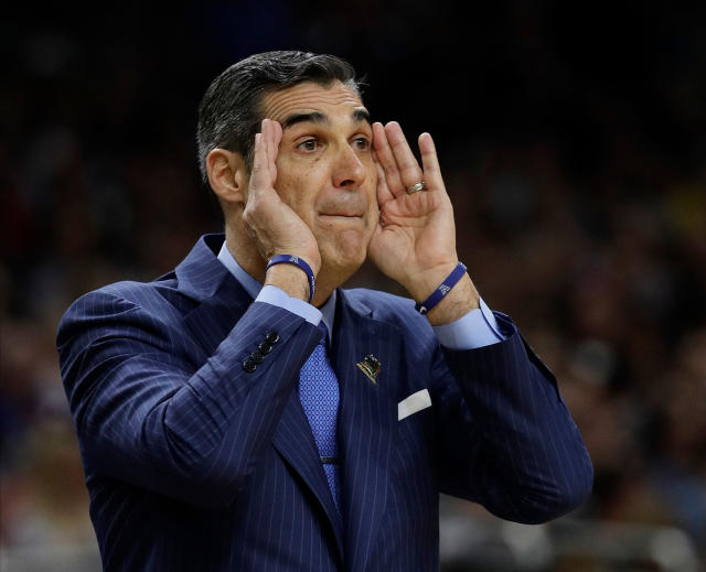 Villanova head coach Jay Wright directs his team during the first half in the championship game of the Final Four NCAA college basketball tournament against Michigan, Monday, April 2, 2018, in San Antonio. (AP Photo/David J. Phillip)