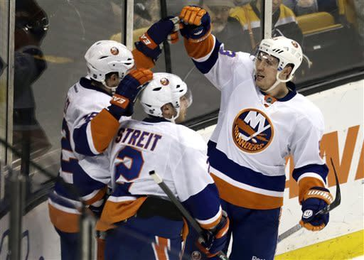 New York Islanders center Casey Cizikas, right, is congratulated by teammates after scoring on Boston Bruins goalie Tuukka Rask during the first period of an NHL hockey game, Thursday, April 11, 2013, in Boston. (AP Photo/Charles Krupa)