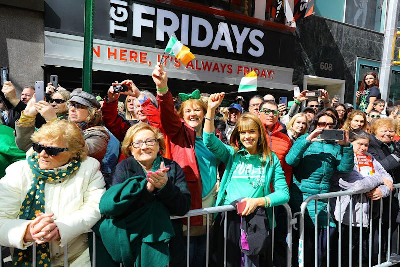 Crowds along Fifth Ave. are dressed fashionably green in clothing for the St. Patrick's Day Parade on March 16, 2019 in New York. (Photo: Gordon Donovan/Yahoo News)