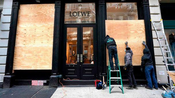 PHOTO: Workers in the Soho area of New York prepare their businesses by boarding up on Nov. 2, 2020, as they make plans for potential civil unrest during the presidential race for the White House. (Timothy A. Clary/AFP via Getty Images)