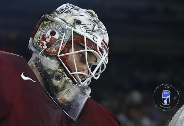 <p>Goalkeeper Elvis Merzlikins of Latvia looks at the puck at the 2017 IIHF World Championships in Cologne, Germany on May 13, 2017. (Photo: Wolfgang Rattay/Reuters) </p>