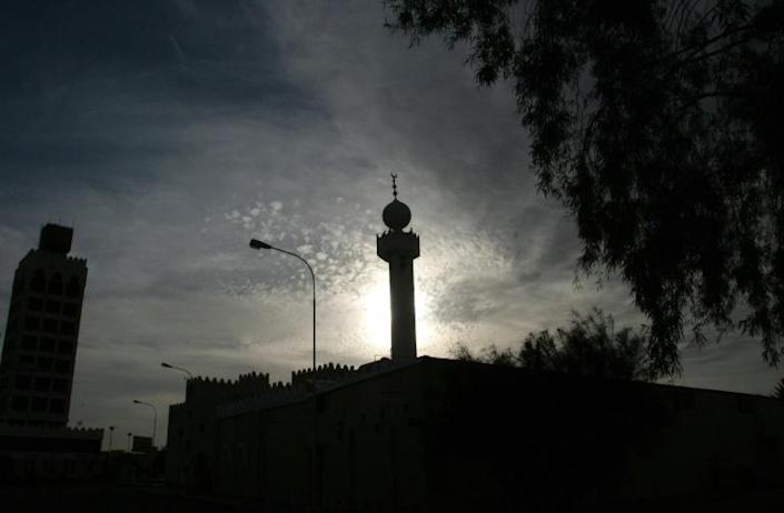 Sun sets behind a mosque in the Saudi city of Hael