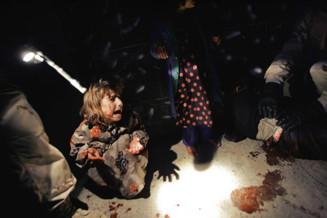 <p>Samar Hassan screams after her parents were killed by U.S. Soldiers with the 25th Infantry Division in a shooting January 18, 2005 in Tal Afar, Iraq. The troops fired on the Hassan family car when it unwittingly approached them during a dusk patrol in the tense northern Iraqi town. Parents Hussein and Camila Hassan were killed instantly, and a son Racan, 11, was seriously wounded in the abdomen. Racan, who lost the use of his legs, was treated later in the U.S. (Photo by Chris Hondros/Getty Images) </p>