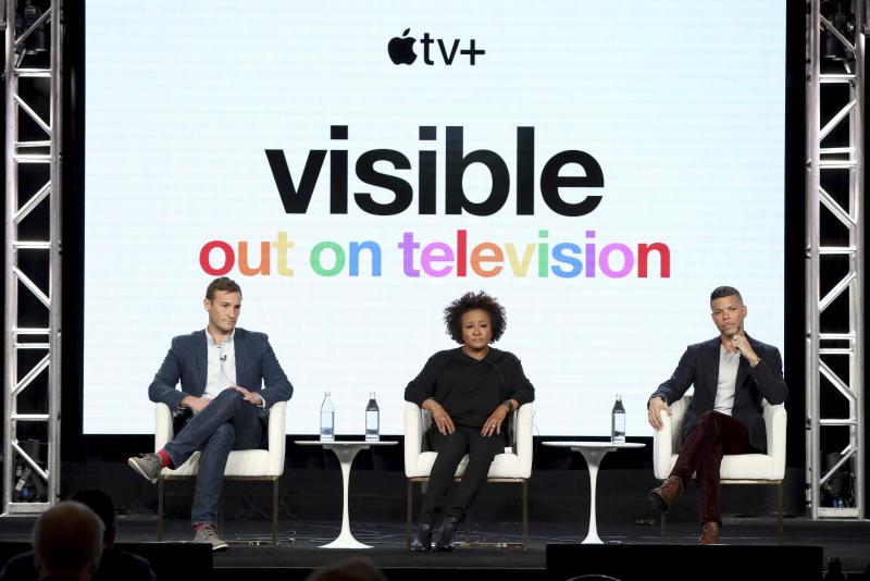 "Ryan White, from left, Wanda Sykes and Wilson Cruz speak at the ""Visible: Out on Television"" panel during the Apple+ TCA 2020 Winter Press Tour at the Langham Huntington, Sunday, Jan. 19, 2020, in Pasadena, Calif. (Photo by Willy Sanjuan/Invision/AP)"
