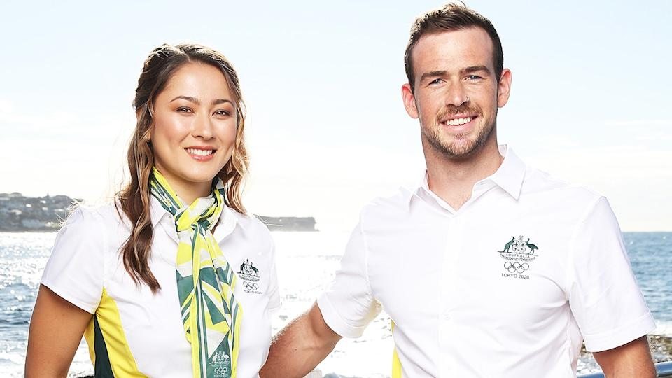Australian athletes Gronya Somerville (L) and Dan Watkins (R) pose during the launch of the Australian 2020 Tokyo Olympic Games Opening Ceremony Uniform.