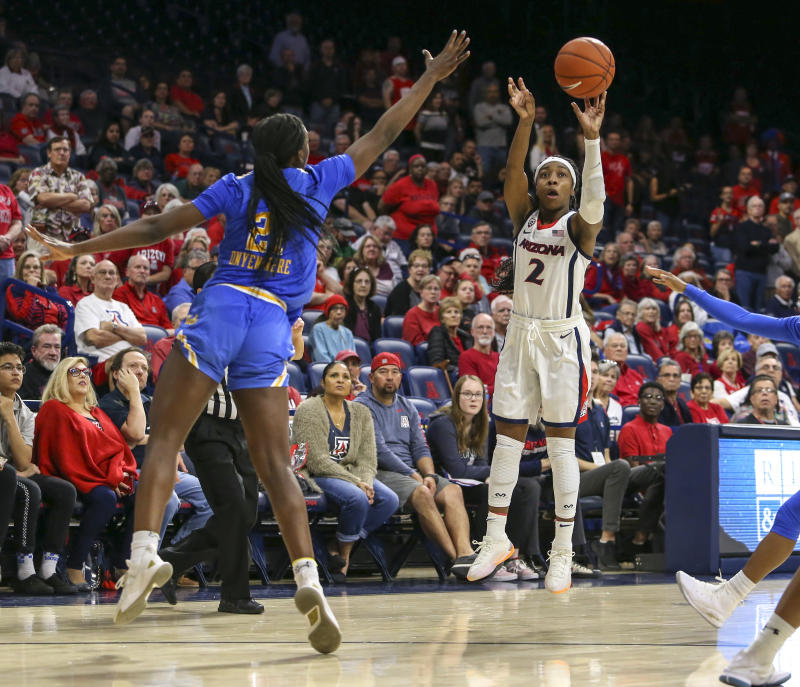 TUCSON, AZ - JANUARY 27: Arizona Wildcats guard Aarion McDonald (2) shoot a three point shot to send the game into triple overtime during a college women's basketball game between the UCLA Bruins and the Arizona Wildcats on January 27, 2019, at McKale Center in Tucson, AZ. (Photo by Jacob Snow/Icon Sportswire via Getty Images)