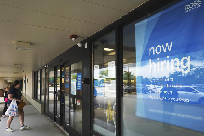 A hiring sign is displayed at a retail store in Schaumburg, Ill., Thursday, July 15, 2021. The number of Americans applying for unemployment benefits has reached its lowest level since the pandemic struck last year, further evidence that the U.S. economy and job market are quickly rebounding from the pandemic recession. Thursday's report from the Labor Department showed that jobless claims fell by 26,000 last week to 360,000.(AP Photo/Nam Y. Huh)