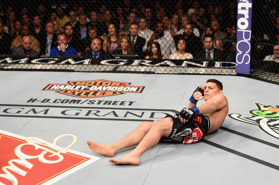 LAS VEGAS, NV - JANUARY 31:  Nick Diaz taunts his opponent in their middleweight bout during the UFC 183 event at the MGM Grand Garden Arena on January 31, 2015 in Las Vegas, Nevada.  (Photo by Josh Hedges/Zuffa LLC/Zuffa LLC via Getty Images)