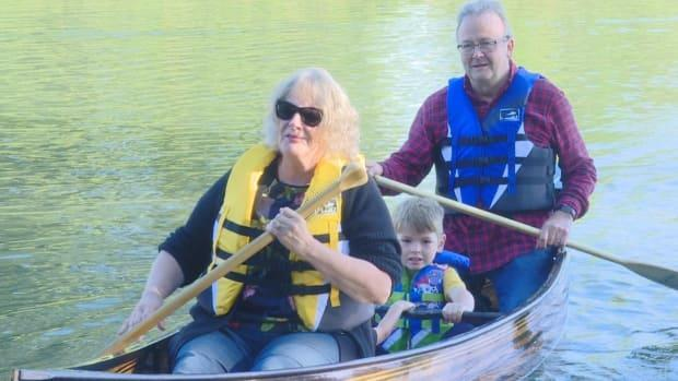 George Klassen, pictured here with his wife Cathy and two of his grandchildren, made a boat by recycling three pianos destined for the dump. (Janella Hamilton/CBC - image credit)