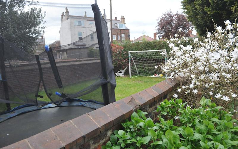 A set of goal posts in the next door neighbours' garden - Credit: Hull Daily Mail / SWNS.com