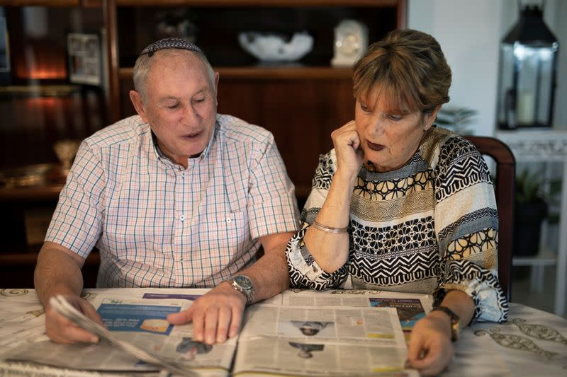 British immigrants to Israel, Harvey Seitz, and his wife Susan, look at Jewish newspapers they received from Britain, during an interview with Reuters in Ashkelon, Israel
