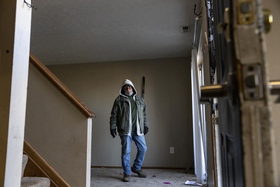 COLUMBUS, OH - MARCH 03: Worker Mark Smolinsky, 68, of Columbus, Ohio searches a home under eviction in the unincorporated community of Galloway on March 3, 2021 west of Columbus, Ohio. Property Management teams are given 1 1/2 hours to remove all items from the property under supervision of the service bailiff. (Photo by Stephen Zenner/Getty Images)