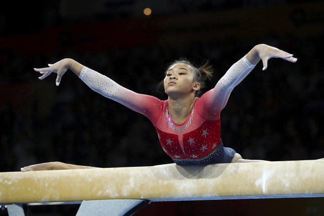 Sunisa Lee of the U.S. performs on the balance beam during women's team final at the Gymnastics World Championships in Stuttgart, Germany, Tuesday, Oct. 8, 2019. (AP Photo/Matthias Schrader)