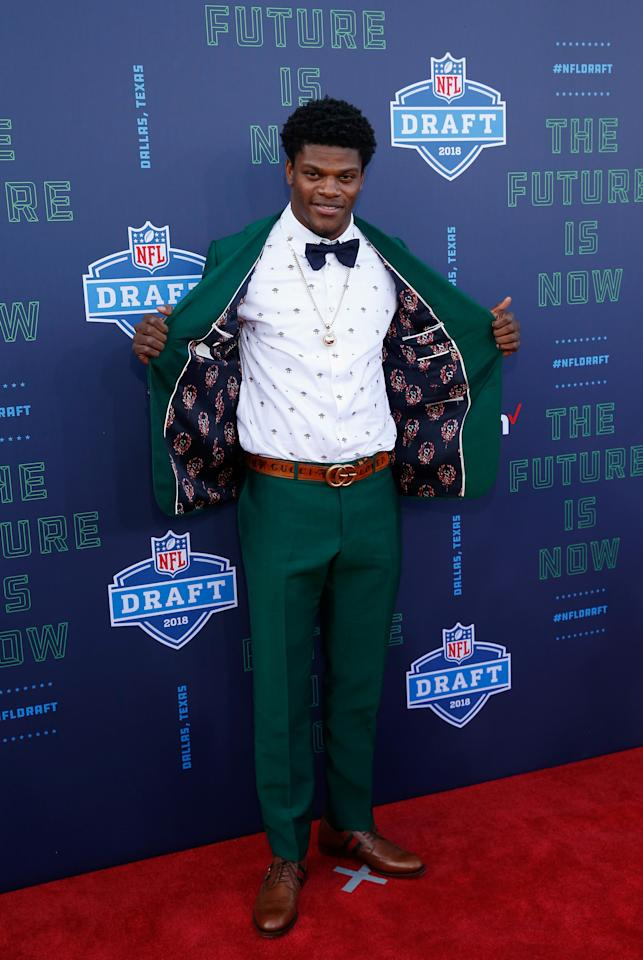 <p>Lamar Jackson of Louisville poses on the red carpet prior to the start of the 2018 NFL Draft at AT&T Stadium on April 26, 2018 in Arlington, Texas. (Photo by Tim Warner/Getty Images) </p>