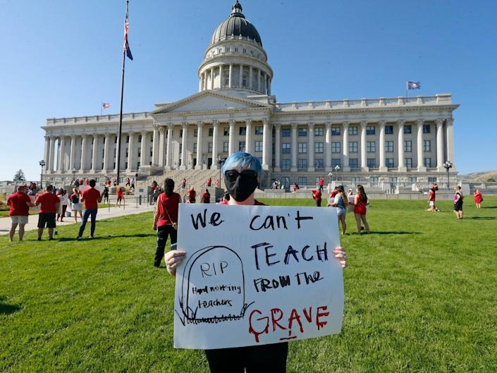 School teacher Brittany Goddard protests at the Utah State Capitol, Friday, Aug. 7, 2020, in Salt Lake City, Utah.