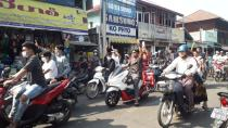 People on motorcycles raise a three-finger salute as take part in a protest against the military coup, in Dawei