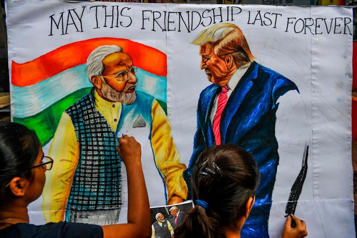 Students in Mumbai paint an image of President Donald Trump and Prime Minister Narendra Modi on Feb. 21, 2020, ahead of Trump's visit to India. (Photo: INDRANIL MUKHERJEE/AFP via Getty Images)