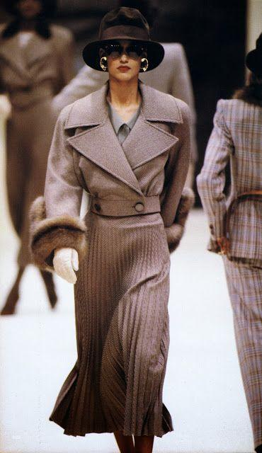 <p>For the Italian fashion house's Fall/Winter 1998 show, a model wore a cropped trench coat complete with fur cuffs and large golden earrings. </p>