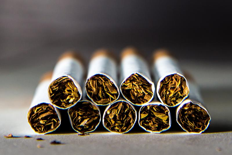 Nine cigarettes in a five-and-four pile.