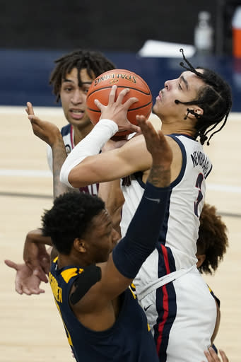 Gonzaga's Andrew Nembhard (3) shoots against West Virginia's Gabe Osabuohien (3) during the second half of an NCAA college basketball game Wednesday, Dec. 2, 2020, in Indianapolis. (AP Photo/Darron Cummings)