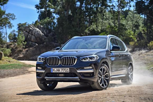 A 2018 BMW X3, a compact luxury SUV, on a dirt road.