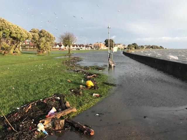 Storm Brendan left flooding on the promenade after waves hit the sea wall at Clontarf, Co Dublin, Ireland (PA/Getty)