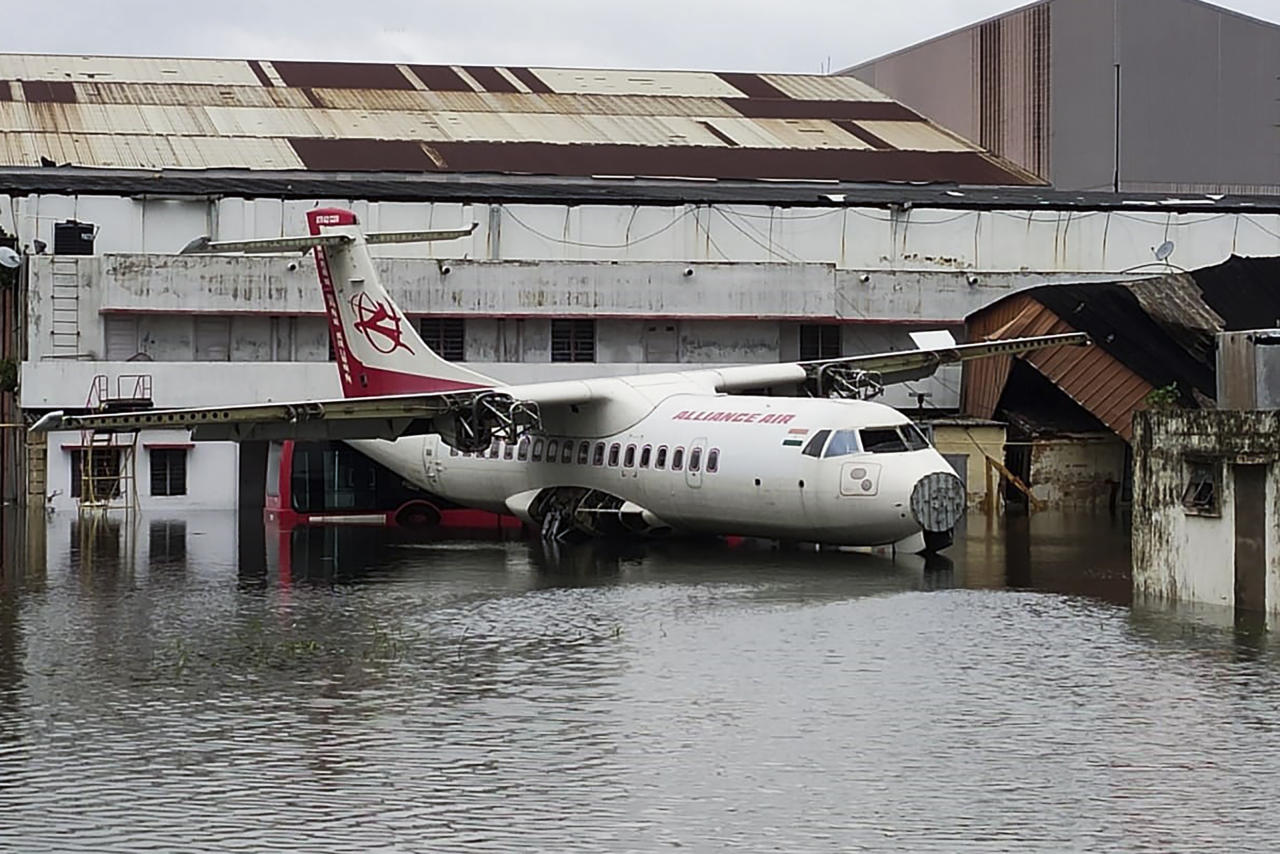 An aircraft is parked at the flooded Netaji Subhas Chandra Bose International Airport after the landfall of cyclone Amphan in Kolkata on May 21, 2020. - The most powerful cyclone to hit Bangladesh and eastern India in more than 20 years tore down homes, carried cars down flooded streets and claimed the lives of more than a dozen people. (Photo by - / AFP) (Photo by -/AFP via Getty Images)