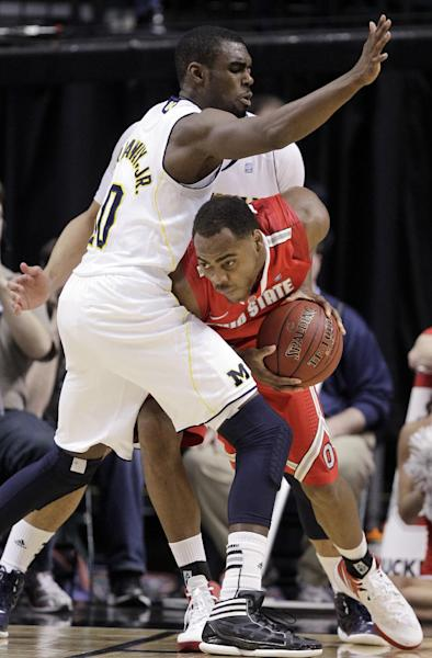 Ohio State forward Deshaun Thomas, right, drives against Michigan guard Tim Hardaway Jr. in the second half of an NCAA college basketball game in the semifinals of the Big Ten Conference tournament in Indianapolis, Saturday, March 10, 2012. (AP Photo/Michael Conroy)