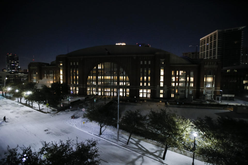 In order to save electricity, the promenade lights and screens are turned off in front of American Airlines Center which was to host the Nashville Predators and the Dallas Stars NHL hockey game, Monday, Feb. 15, 2021, in Dallas. Dallas Mayor Eric Johnson requested that the teams not play Monday due to a shortage of electricity in the region. (AP Photo/Brandon Wade)