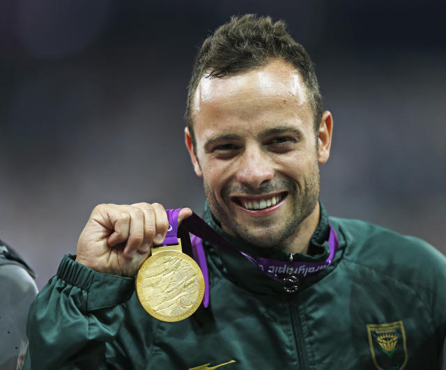 South Africa's Oscar Pistorius celebrates with his gold medal after winning the men's 400m T44 classification at the Olympic Stadium during the London 2012 Paralympic Games September 8, 2012. REUTERS/Eddie Keogh (BRITAIN - Tags: SPORT OLYMPICS ATHLETICS HEADSHOT) - RTR37PDE