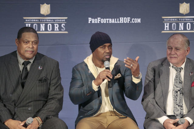 Former Eagles and Broncos safety Brian Dawkins, center, revealed he's battled depression for much of his adult life. (AP)