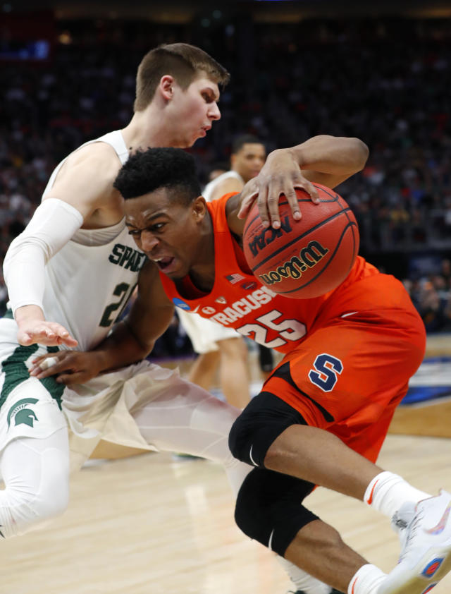 Syracuse guard Tyus Battle (25) drives on Michigan State guard Matt McQuaid (20) during the second half of an NCAA men's college basketball tournament second-round game in Detroit, Sunday, March 18, 2018. (AP Photo/Paul Sancya)