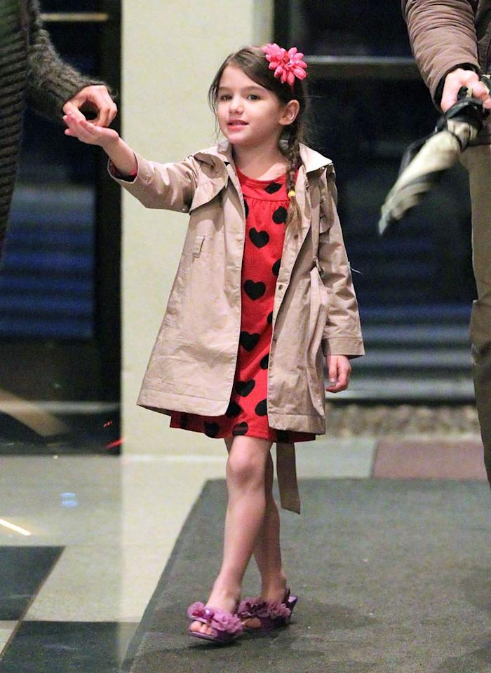 """Bottles, pacifiers, $1,700 Dolce & Gabanna bags, and now her own personal assistant,"" begins a HollywoodLife story about Suri Cruise. According to the site, Tom Cruise and Katie Holmes' four-year-old has a personal assistant ""who is there to cater to her every beck and call."" The blog even has a photo of the little girl's hired help, and points out how he's ""keeping a tight grip on spoiled Suri's lollipop."" For how long Suri has had a personal assistant and what he's forced to do, click over to <a href=""http://www.gossipcop.com/suri-cruise-personal-assistant-hired-help-katie-holmes-bodyguard-security/"" target=""new"">Gossip Cop</a>. Jackson Lee/<a href=""http://www.splashnewsonline.com"" target=""new"">Splash News</a> - March 16, 2011"