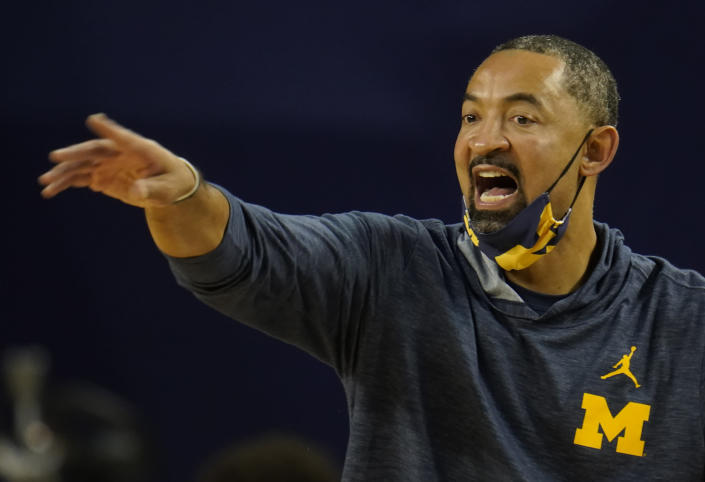FILE - Michigan head coach Juwan Howard gestures during the first half of an NCAA college basketball game against Ball State in Ann Arbor, Mich., in this Wednesday, Dec. 2, 2020, file photo. Michigan coach Juwan Howard was honored as The Associated Press men's basketball coach of the year on Thursday, April 1, 2021. (AP Photo/Paul Sancya, File)