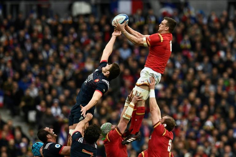 Wales' flanker Sam Warburton (up R) catches the ball in a line-out during the Six Nations tournament Rugby Union match between France and Wales at the Stade de France in Saint-Denis, outside Paris, on March 18, 2017