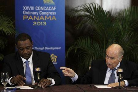 "Joseph ""Sepp"" Blatter (R) gestures next to Jeffrey Webb during a news conference at the CONCACAF congress in Panama City April 19, 2013. REUTERS/Carlos Jasso"