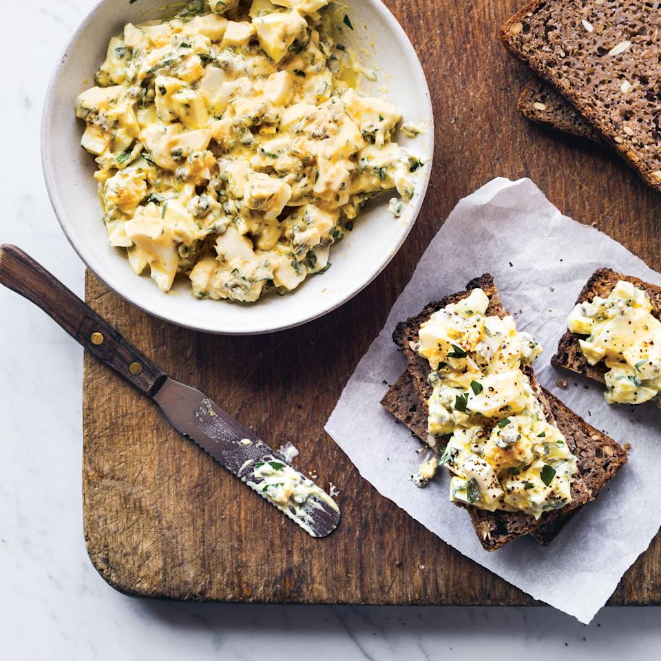 """<p>In this simple version of egg salad, Food & Wine's Kay Chun forgoes mayonnaise in favor of tangy Greek yogurt. She amps up the flavor with herbs like parsley and tarragon as well as tangy capers and crunchy cornichons. This egg salad is excellent on crackers or in a sandwich, but to dress it up, serve it piled on a bed of crisp lettuce or over juicy tomatoes.</p><p><a href=""""https://www.foodandwine.com/recipes/egg-salad-herbs-and-pickles"""">GO TO RECIPE</a></p>"""