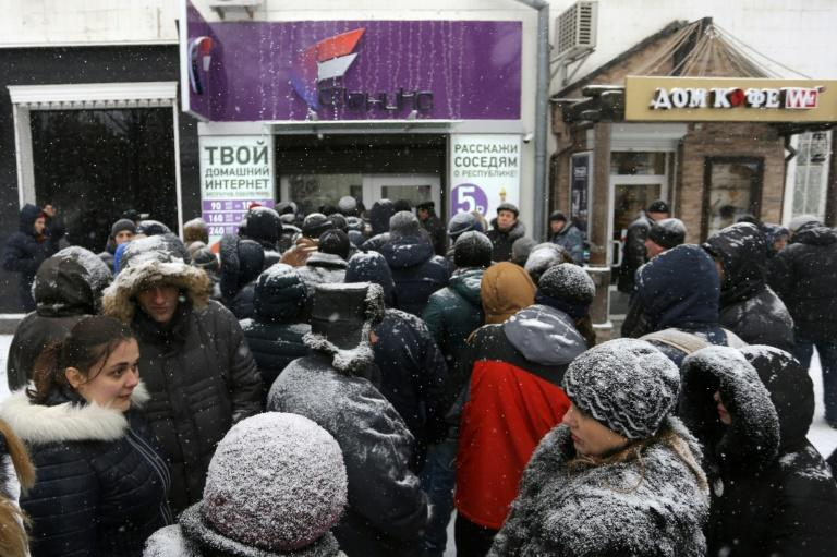 "People queue outside the local mobile operator ""Phoenix"" despite the snow in Donetsk"