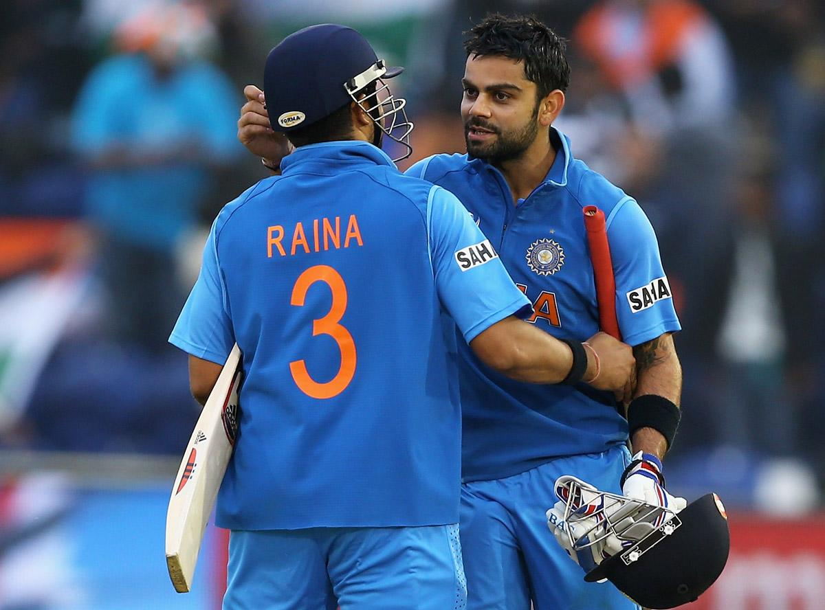 Suresh Raina and Virat Kohli of India celebrate their win over Sri Lanka during the ICC Champions Trophy Semi Final match between India and Sri Lanka at SWALEC Stadium on June 20, 2013 in Cardiff, Wales.  (Photo by Matthew Lewis-ICC/ICC via Getty Images)