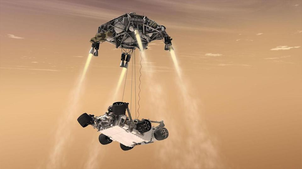 Artist's illustration of NASA's Mars rover Curiosity landing via sky crane in August 2012. NASA's Mars 2020 rover Perseverance will land in the same fashion on Feb. 18, 2021.