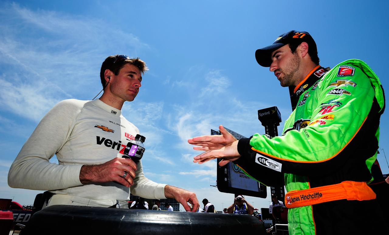 FORT WORTH, TX - JUNE 08:  Will Power of Australia, driver of the #12 Verizon Team Penske Chevrolet Dallara, talks to James Hinchcliffe of Canada, driver of the #27 Team GoDaddy.com Chevrolet Dallara, during practice for the IZOD IndyCar Series Firestone 550 at Texas Motor Speedway on June 8, 2012 in Fort Worth, Texas.  (Photo by Robert Laberge/Getty Images for Texas Motor Speedway)